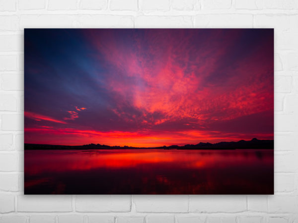 Lake Havasu City Sunrise wall art 36 inches on metal print with interior of modern living room with chair 3D rendering